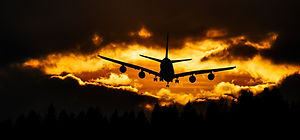 airplane-silhouette-on-air-during-sunset