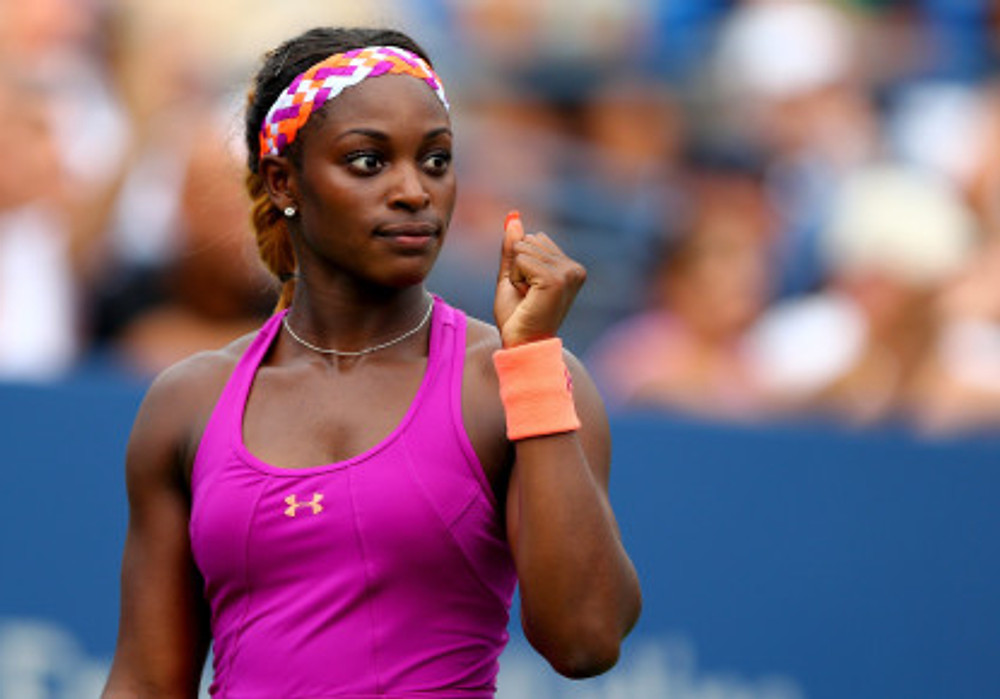 NEW YORK, NY - AUGUST 26:  Sloane Stephens of the United States reacts after a point against Mandy Minella of Luxembourg during their first round women's singles match on Day One of the 2013 US Open at USTA Billie Jean King National Tennis Center on August 26, 2013 in the Flushing neighborhood of the Queens borough of New York City.  (Photo by Elsa/Getty Images)
