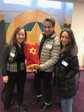 Beth Kopin (executive producer), Marc Bennett (director and co-screenwriter) and Lisa Effress (producer) at Solomon Schechter Day School in Chicago with the little tattooed Torah.