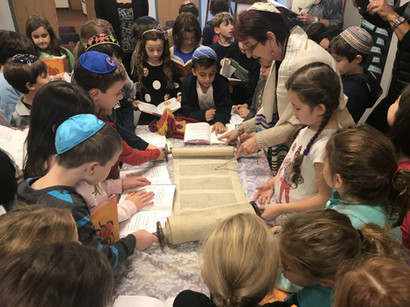 Students at Solomon Schechter Day School in Chicago, with the little tattooed Torah.