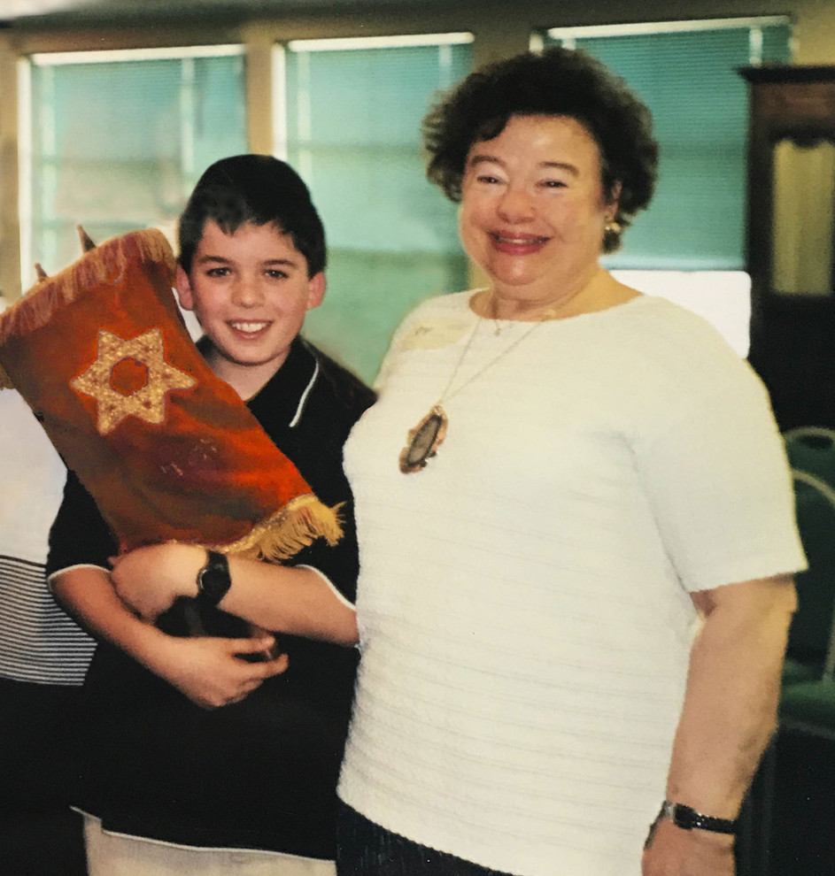 A young Brett Kopin, with the little tattooed Torah that the book is based on, with his grandmother Marvell Ginsburg, at Solomon Schechter School in Chicago.