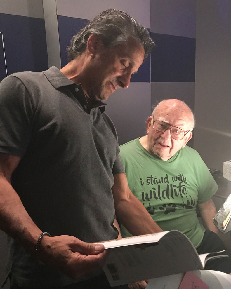 Marc Bennett (director and co-screenwriter) with Ed Asner at recording session.