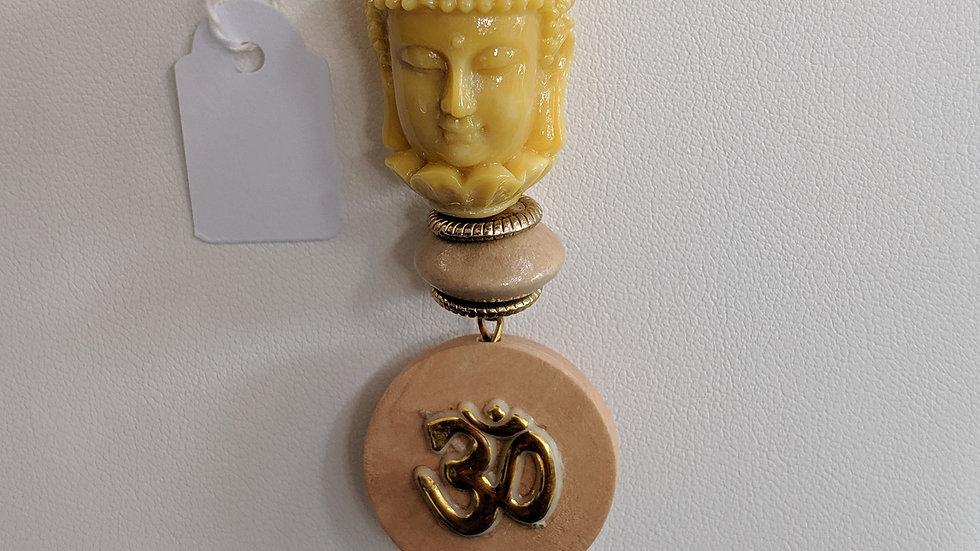 Collier jaune et doré avec Buddha et Om