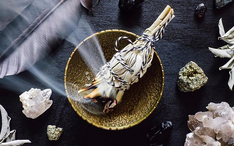 Smudging-with-white-sage-oi8g4detbdvuip3