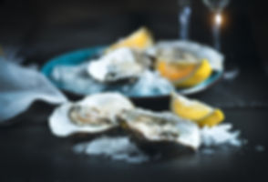 Fresh Oysters close-up on blue plate, se