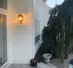 Commack porch light installation.