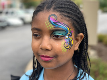 eye swirl face painting