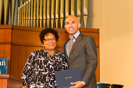 Dr. Viceisza receiving Vulcan Award for Excellence in Teaching from Dr. Myra Burnett