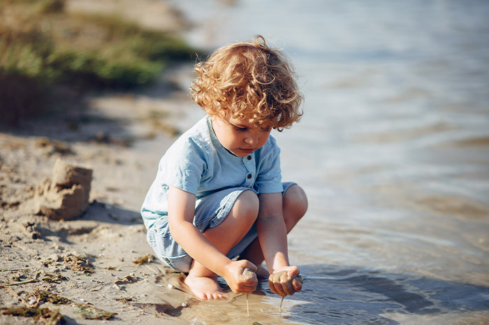 Sand and water play by child