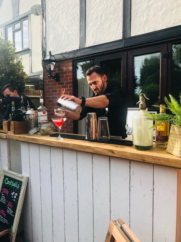 Bartender serves Cocktails