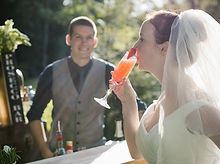 Bride Drinks Cocktail at Wedding Bar