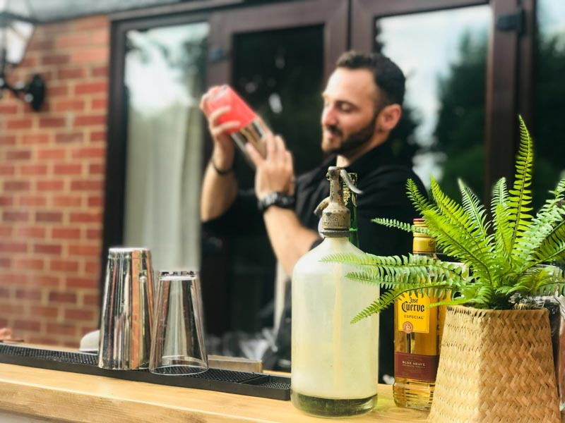 Private Bartender Shakes Cocktail