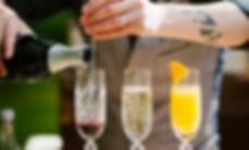 Bartender Makes Champagne Cocktails in Crystal Glasses