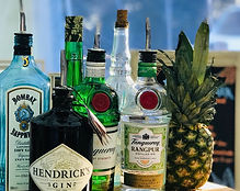 Gin bottles and pineapple