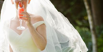 Wedding Bride enjoys cocktail