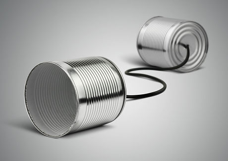Tin can telephone with cord on grey, tel