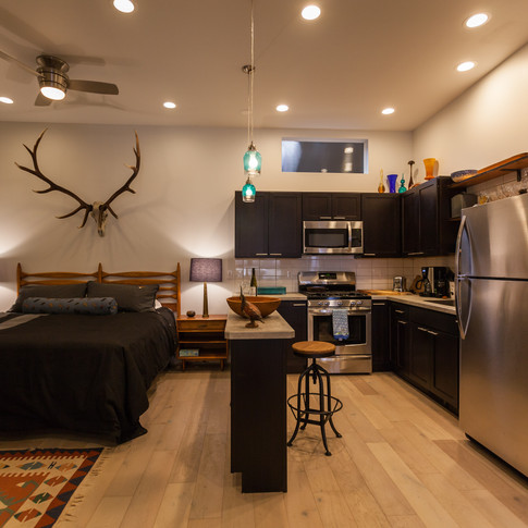 Fully equipped kitchen and a king sized bed.
