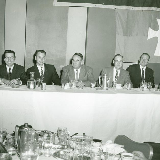 1958 John Wayne dinner: L to R; Chapter Advisor Fred Marshall, Consul Bill Shaeffer, football great Morley Drury, TSF President Field Thompson, John Wayne, MC Gordon Campbell