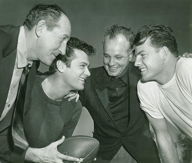 "Jesse Hibbs (AU 1929), 3rd from left, was a two-time Trojan football All-American tackle who then directed ""All American"" starring Tony Curtis with ball and Frank Gifford, far right"