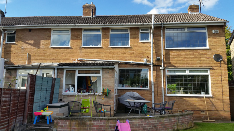 Prior to extension, all the soil and rain pipes were visible and the offshot opened onto a small patio.
