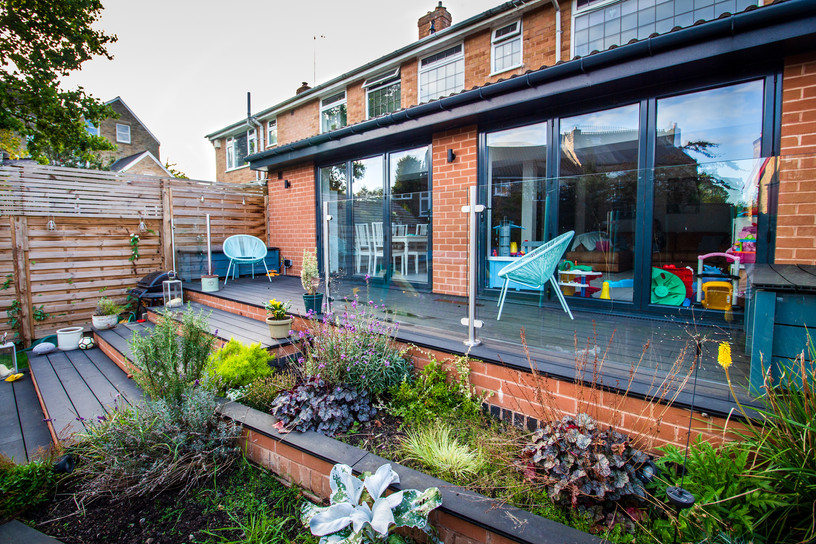 The level difference was negotiated with beautiful timber decking and stepped plant beds.