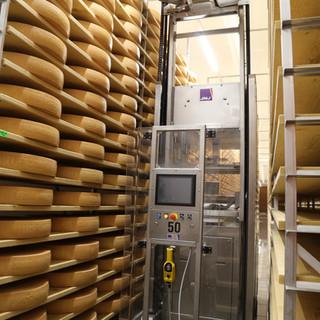 Robot de soin du fromage au travail