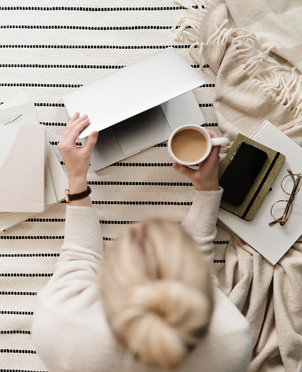 Woman working on website drinking coffee
