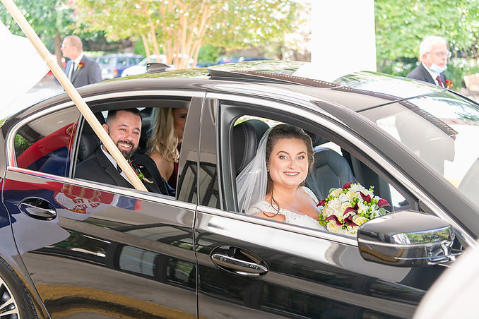 Bride and Groom in a Car.jpg