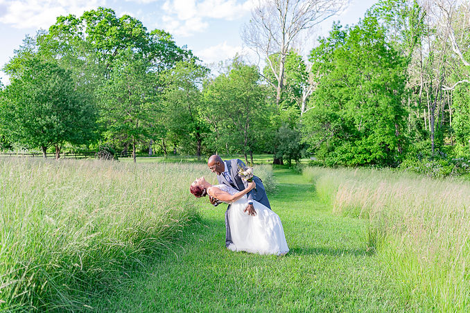 Groom dips Bride for a kiss in Virginia wedding