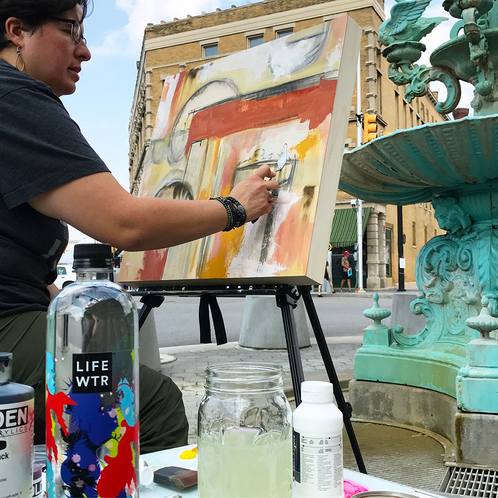 Mixing colors and using a palette knife to paint