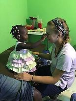 Haitian girl and nurse