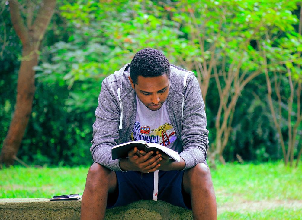 Guy reading Bible