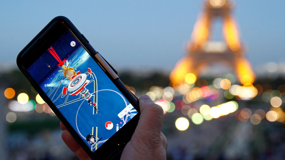 A tourist plays Nintendo Co.'s Pokemon Go augmented-reality game at the Trocadero in front of the Eiffel tower on Sept. 8, 2016 in Paris. The Pokemon GO game allows players to hunt on their smartphone or tablet virtual creatures scattered in public spaces