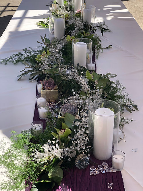 Tablescapearland with candles, succulents, beaded garland, succulents and votive