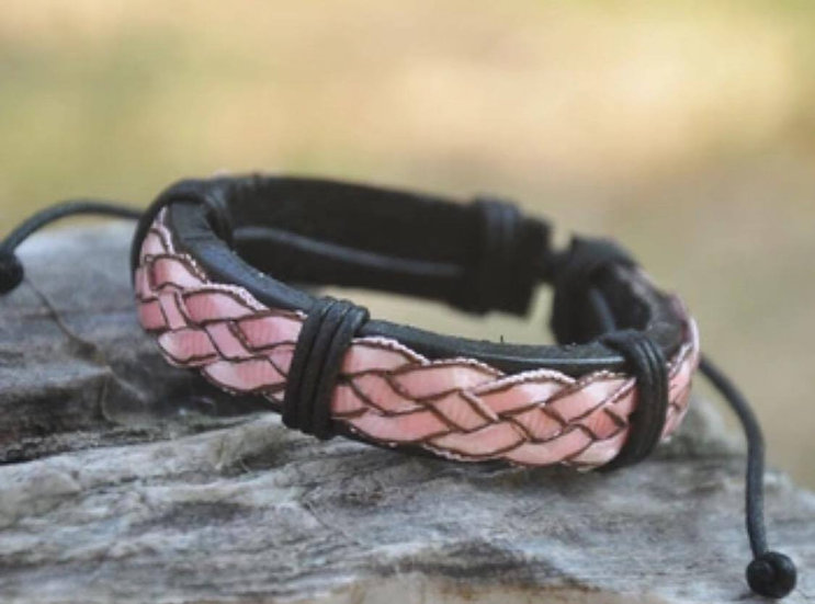 Pink satin ribbon over leather base