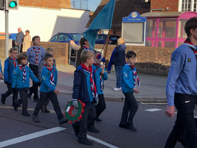 Beavers march with flag.jpg