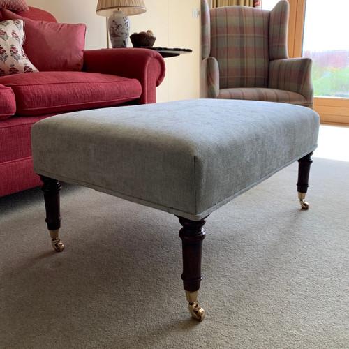 A smaller, taller footstool