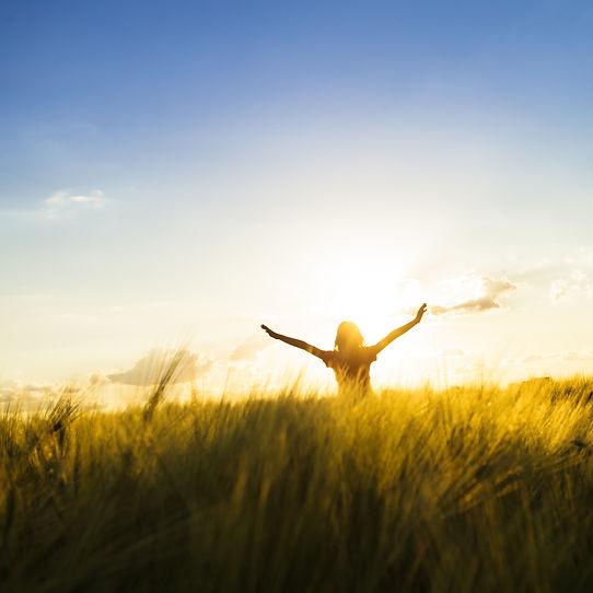Teenage girl enjoy with sunshine in whea