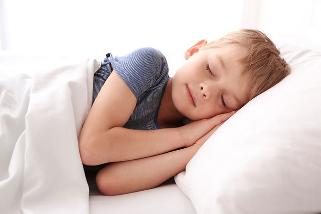 Adorable little boy sleeping in bed.jpg
