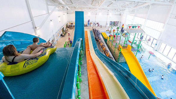 A photograph of slides going down into a pool in a leisure centre