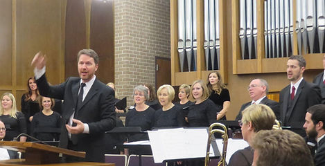 Paul Busselberg conducting a concert wih CONSONO and OMNI Brass, December 2015