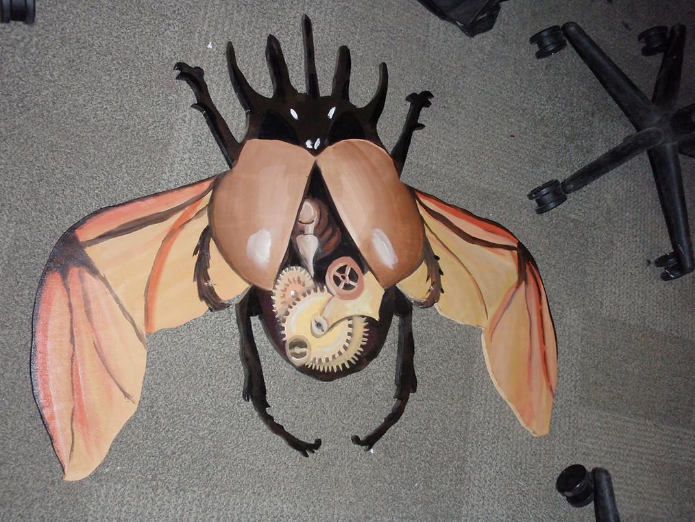 Painted bug emblem