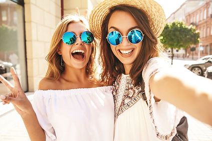 Two young female smiling hippie brunette
