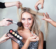 many hands applying make up on a woman h