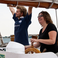 Adult trainee learning to helm Fair Jeanne.