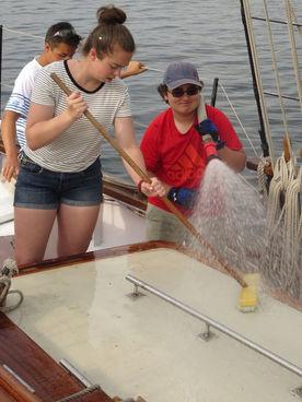 Trainee swabbing the deck. Summer camp.
