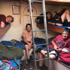 Trainees hanging out in their bunks after dinner on Black Jack.