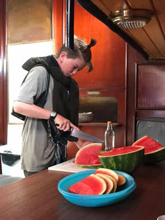 Cutting up a watermelon for snack time. Summer camp.