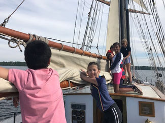 Trainees having a great time on deck. Summer camp.