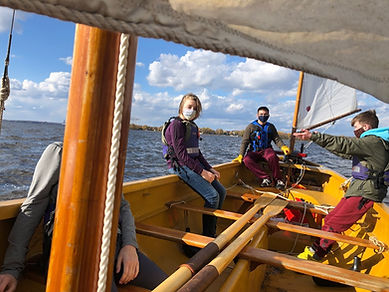 Trainees in a boat. Summer camp.